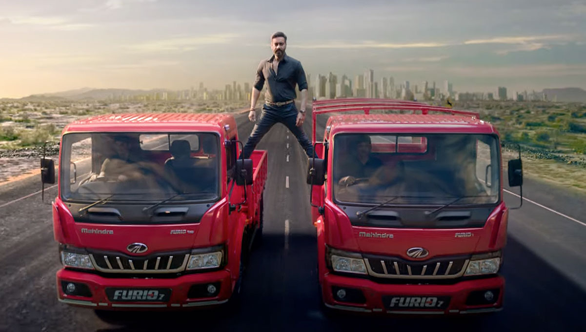 Ajay Devgn Re-Enacts his Iconic Motorbike Split on Two Trucks for Mahindra